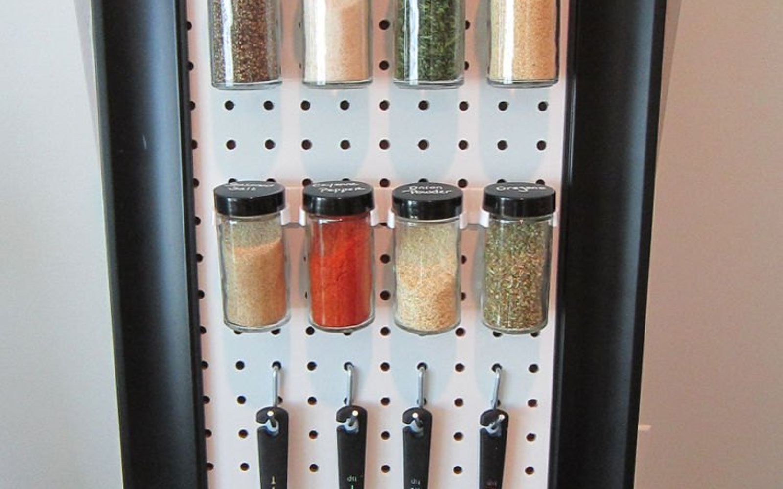 s 15 ways to organize every messy nook with pegboard, organizing, woodworking projects, Make an easy spice rack for a kitchen wall