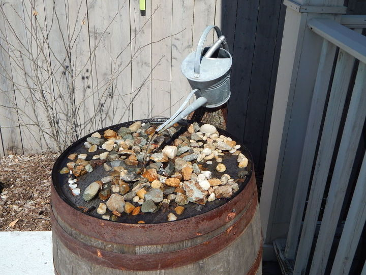 wine barrel fountain with vintage watering can, ponds water features