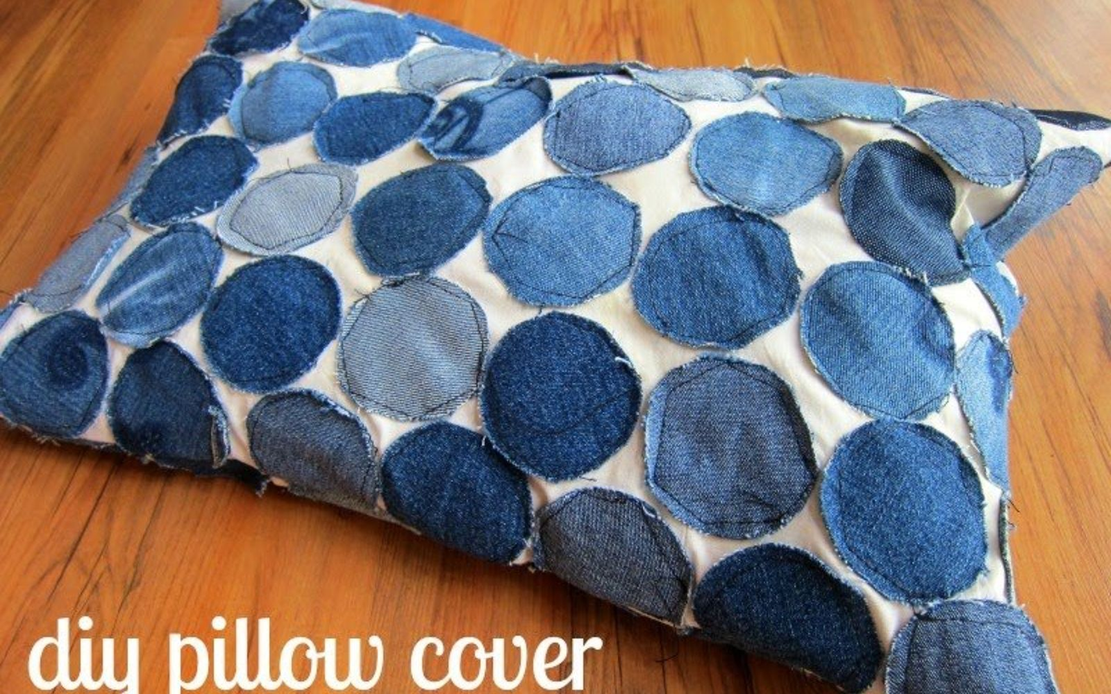 s 19 gorgeous reasons to dig your old jeans out of the closet, crafts, repurposing upcycling, Cover a throw pillow in cut jean circles