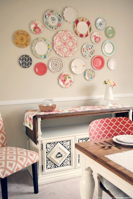 s 17 reasons to drop everything and buy cheap thrift store dishes, crafts, repurposing upcycling, Hang a bunch of plates as a wall collage
