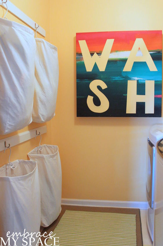 s 11 easy updates that will make you love your laundry room, laundry rooms, Put up racks for hanging laundry bags