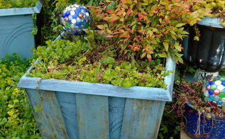 painted pallet boards on a square planter, container gardening, gardening, pallet
