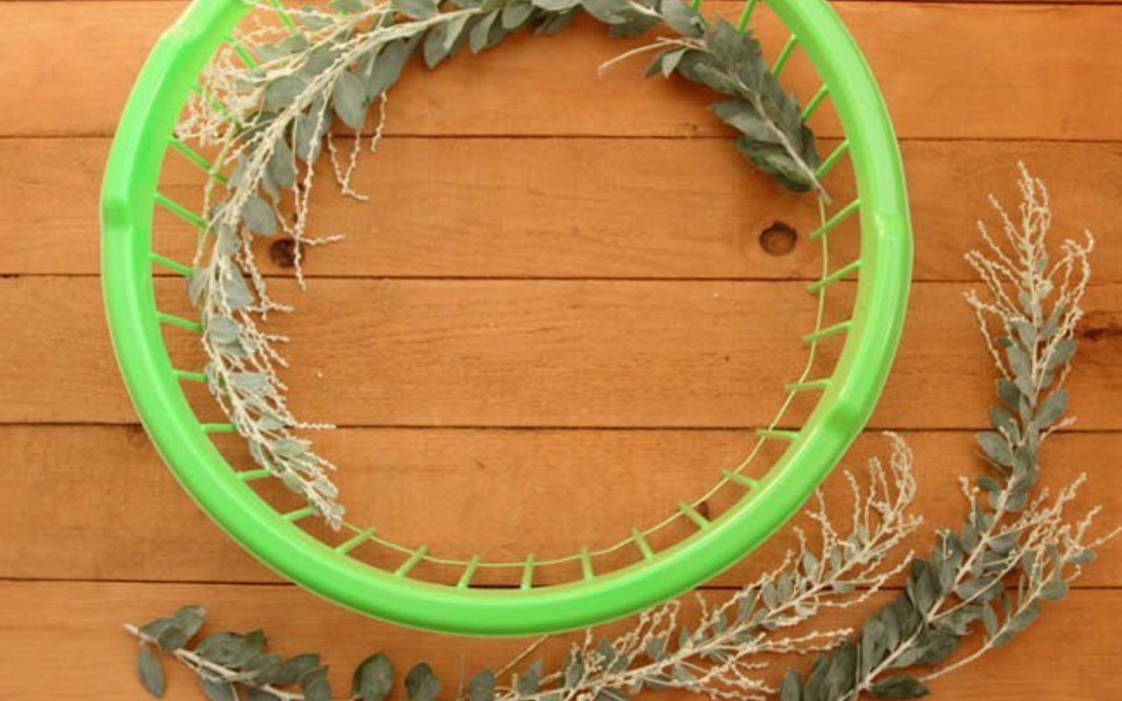 s 14 hidden home decor gems you can find in any dollar store, home decor, repurposing upcycling, That flimsy basket makes the perfect wreath