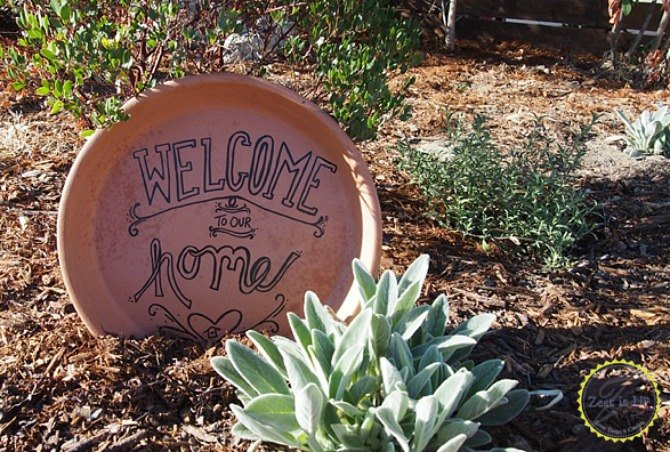 s 13 awesome ways to reuse a terra cotta saucer, container gardening, gardening, repurposing upcycling, Turn a broken saucer into a welcome sign