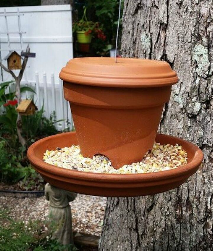 s 13 awesome ways to reuse a terra cotta saucer, container gardening, gardening, repurposing upcycling, Make a hanging bird feeder with a pot