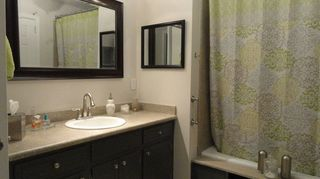 , Vanity is painted dark grey although it almost looks black in this pic I have since changed the wall color to Sherwin Williams Sea Salt a soft green aqua