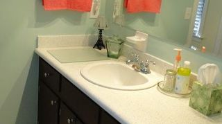 , This bath vanity was painted a dark coffee brown We also had both countertops updated using a chemical bonding method