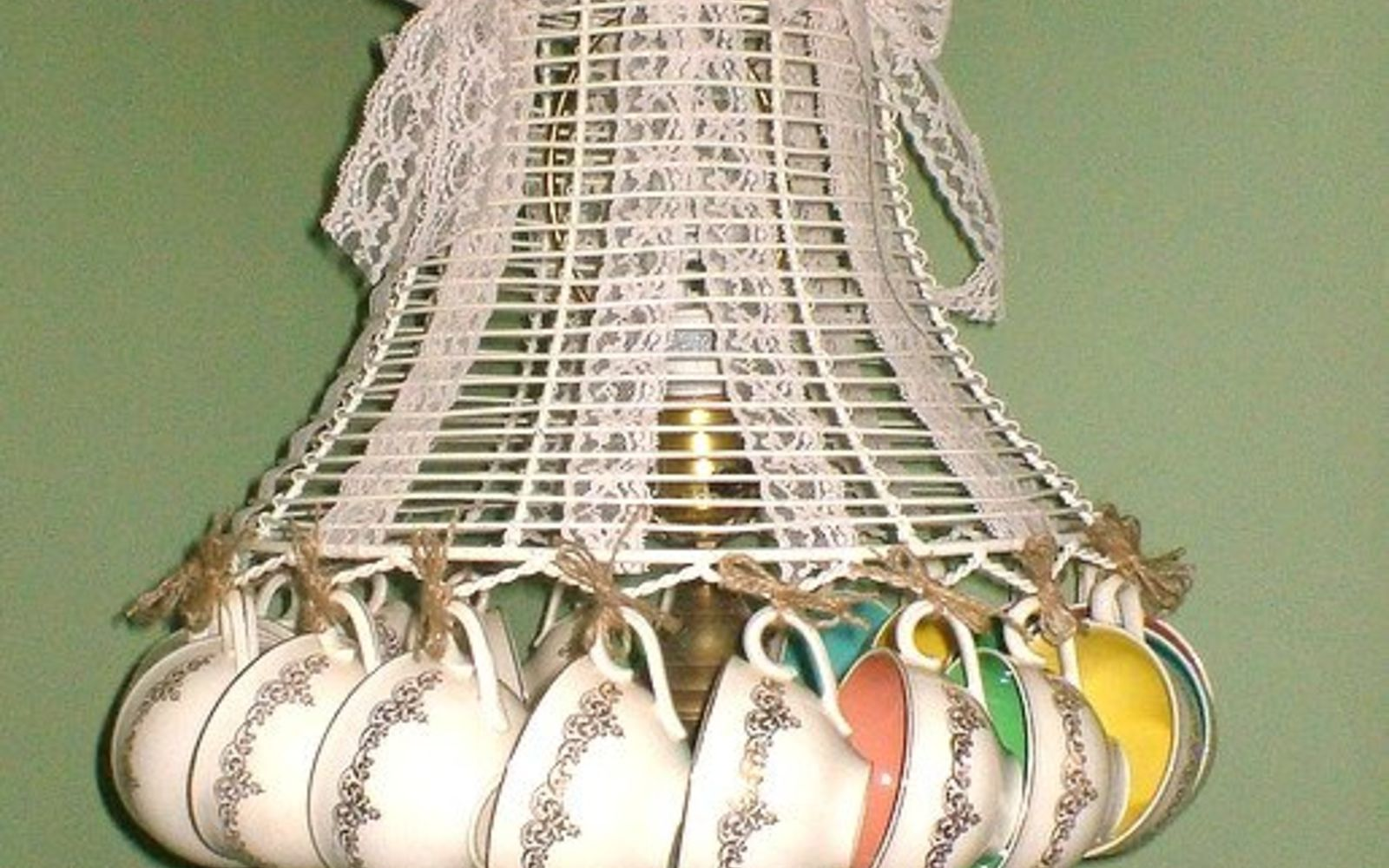 s don t ditch your broken teacups til you see what people do with them, repurposing upcycling, String chipped cups around a lamp frame