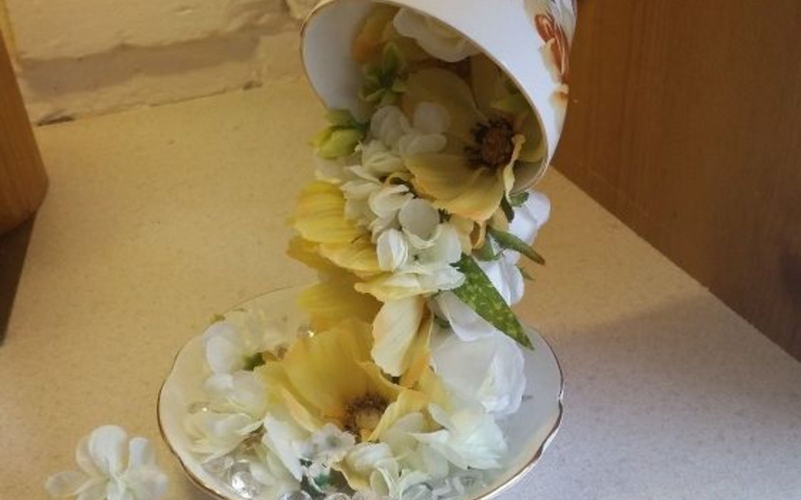 s don t ditch your broken teacups til you see what people do with them, repurposing upcycling, Make a flower fountain with a flipped cup