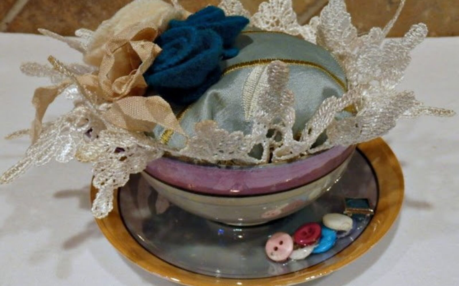 s don t ditch your broken teacups til you see what people do with them, repurposing upcycling, Set a cushion in a cup as cute sewing couture