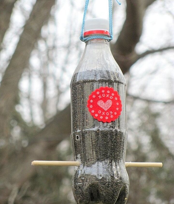 s 17 adorable birdfeeders using things you already own, outdoor living, repurposing upcycling, Poke holes in an empty soda bottle