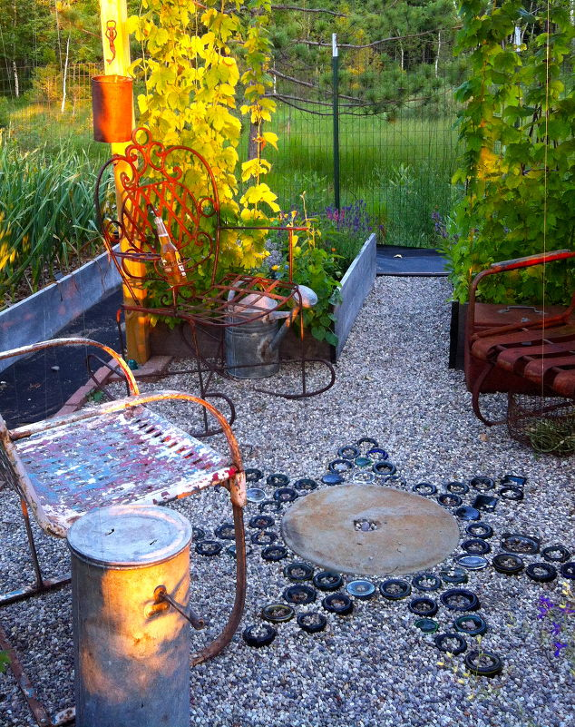 s 15 incredible backyard ideas using empty wine bottles, gardening, outdoor living, repurposing upcycling, Bury a few in your garden as a mosaic