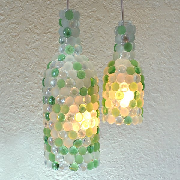 s 15 incredible backyard ideas using empty wine bottles, gardening, outdoor living, repurposing upcycling, Cover bottles in gems for patio lighting