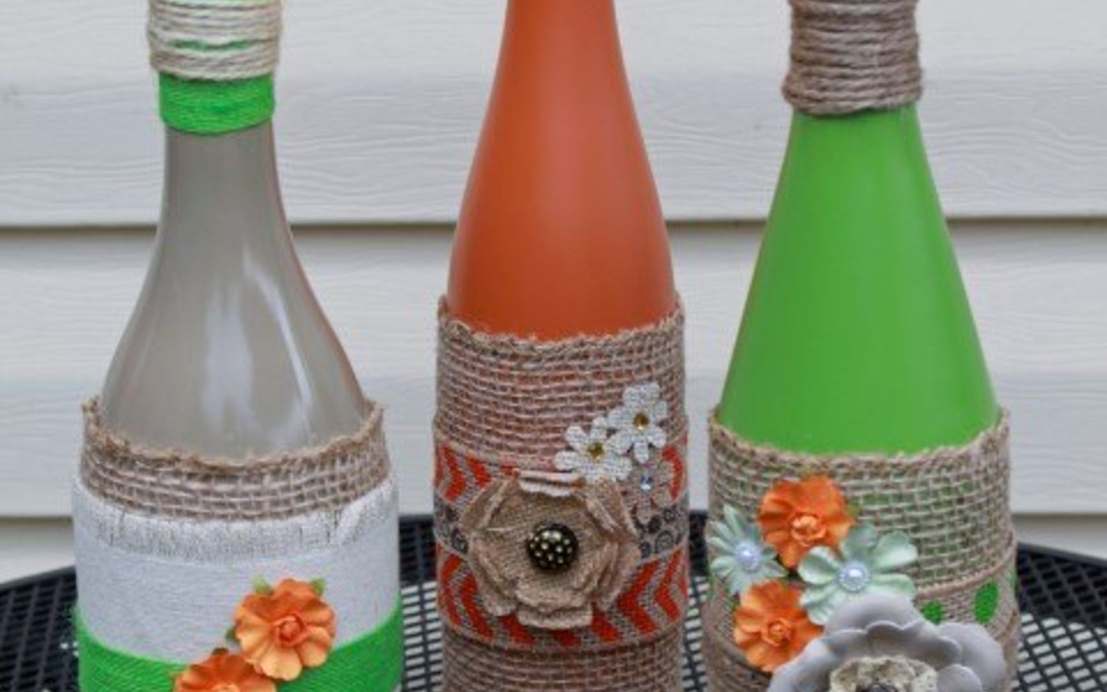 s 15 incredible backyard ideas using empty wine bottles, gardening, outdoor living, repurposing upcycling, Light your backyard corners with tiki torches