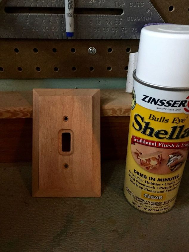 plain wood,toggle type plate. spray shellac
