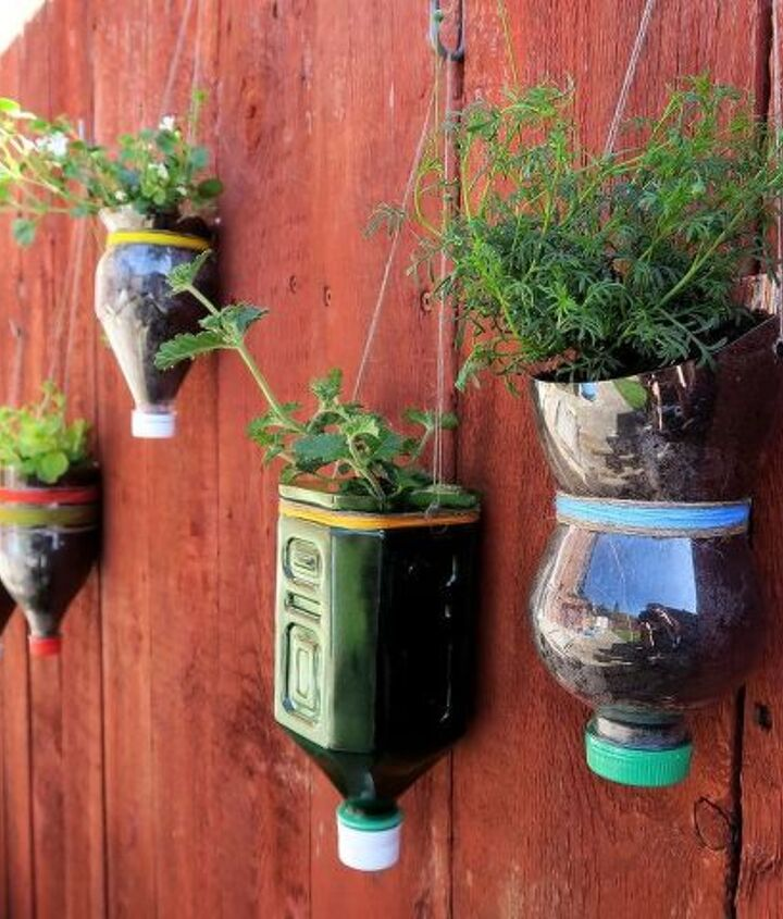 upcycled bottle planters, container gardening, gardening, repurposing upcycling, wall decor