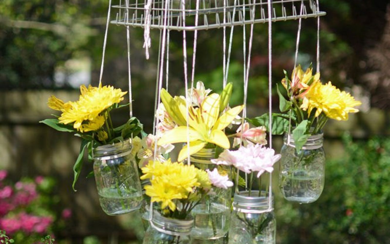 s 11 gardening hacks using empty glass jars, gardening, repurposing upcycling, Bring more blooms into colorless garden spots