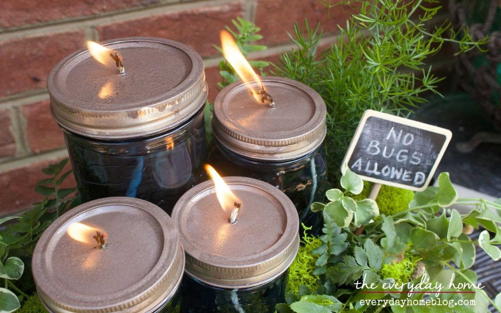 s 11 gardening hacks using empty glass jars, gardening, repurposing upcycling, Make candles to deter bugs while you garden