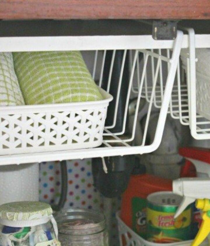 s the 15 smartest storage hacks for under your sink, bathroom ideas, storage ideas, Hang baskets for vertical storage
