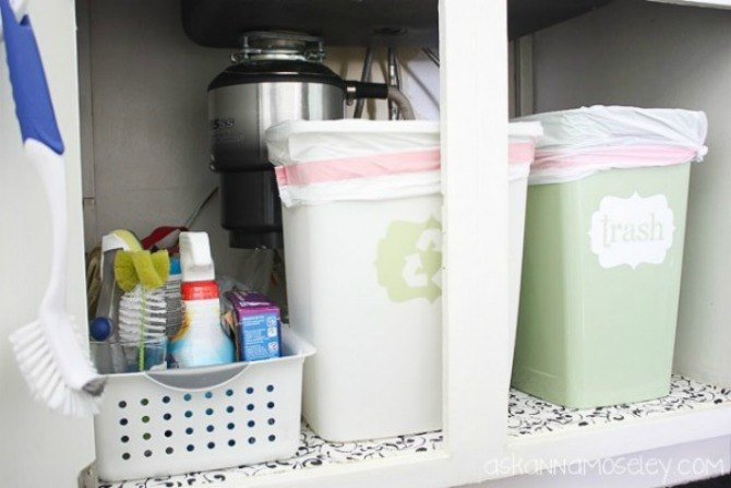 s the 15 smartest storage hacks for under your sink, bathroom ideas, storage ideas, Stow small trash recycling bins on one side