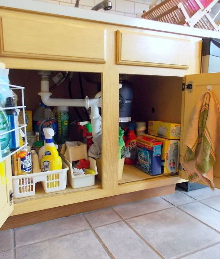 s the 15 smartest storage hacks for under your sink, bathroom ideas, storage ideas, Utilize your cabinet doors with hooks bins