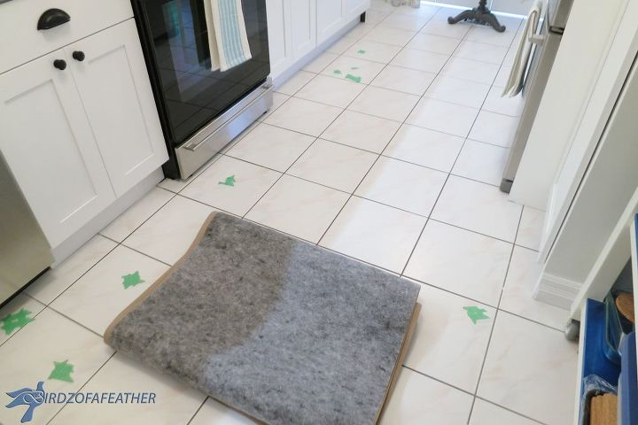 Green tape marks every chip in the floor