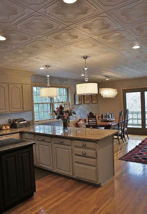 s 17 impossibly creative ceiling ideas that will transform any room, painting, wall decor, Cover a popcorn ceiling with styrofoam tiles