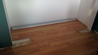 , When the floor was installed the opening was smaller so there wasn t a need for the laminate in those spots To allow for the sliders we ve re framed the closet and cut down the walls which left gaps in the floor