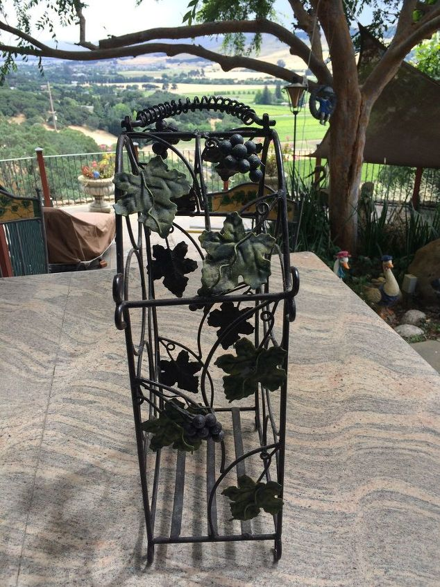 q any ideas on how i can upcycle this bottle holder for outside decor , gardening, home decor, repurpose household items, repurposing upcycling