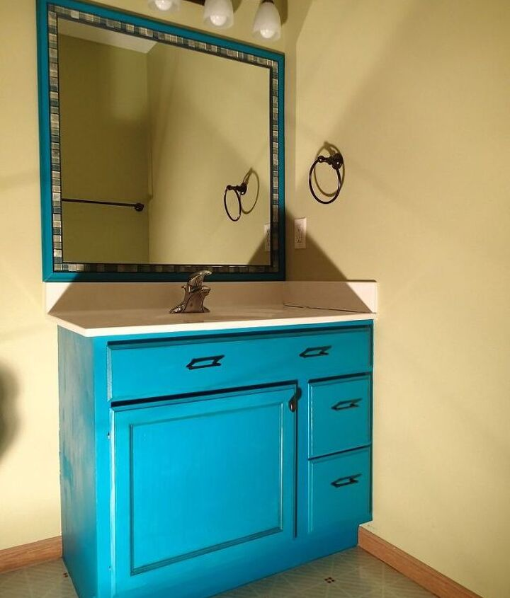 s 11 actually helpful tricks for decorating a small bathroom, bathroom ideas, Add tile borders to builder grade mirrors