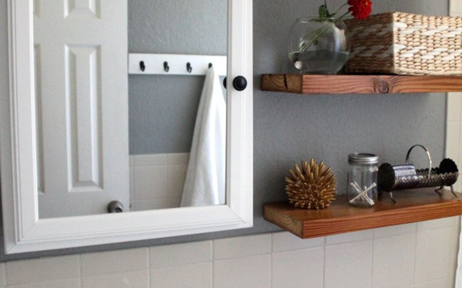 s 11 actually helpful tricks for decorating a small bathroom, bathroom ideas, Use pretty storage that doubles as decor