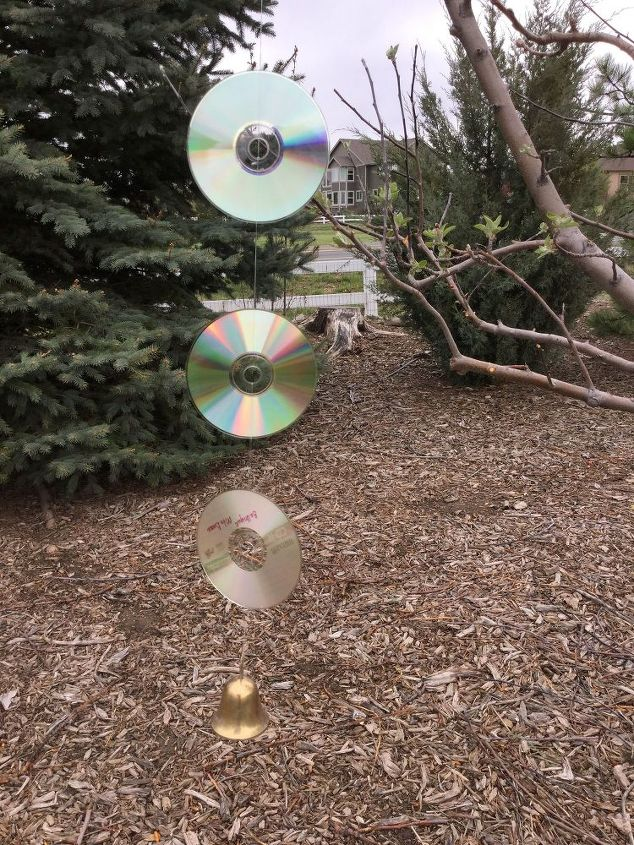 repurposed cds get rid of critters beautiful wind spinner, crafts, gardening, outdoor living, repurposing upcycling
