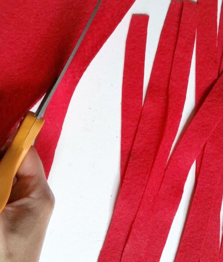 """Start by cutting the felt in 1/2"""" stripes"""