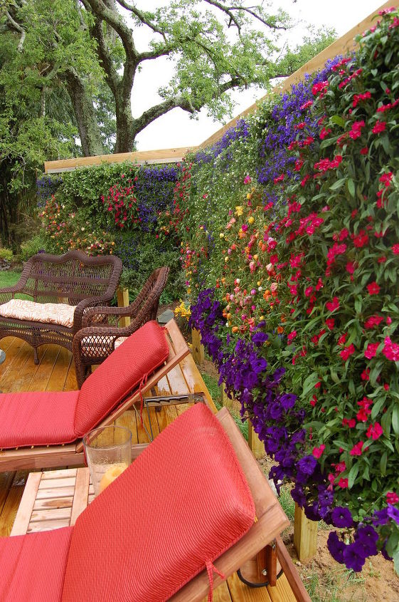 s 13 ways to get backyard privacy without a fence, fences, outdoor living, Hang beautiful bursting vertical planters