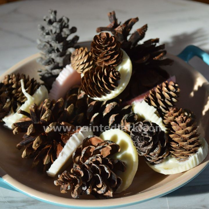 s 9 free fire starters for your summer bbqs, fireplaces mantels, outdoor living, repurposing upcycling, Melt tea lights around crispy pine cones