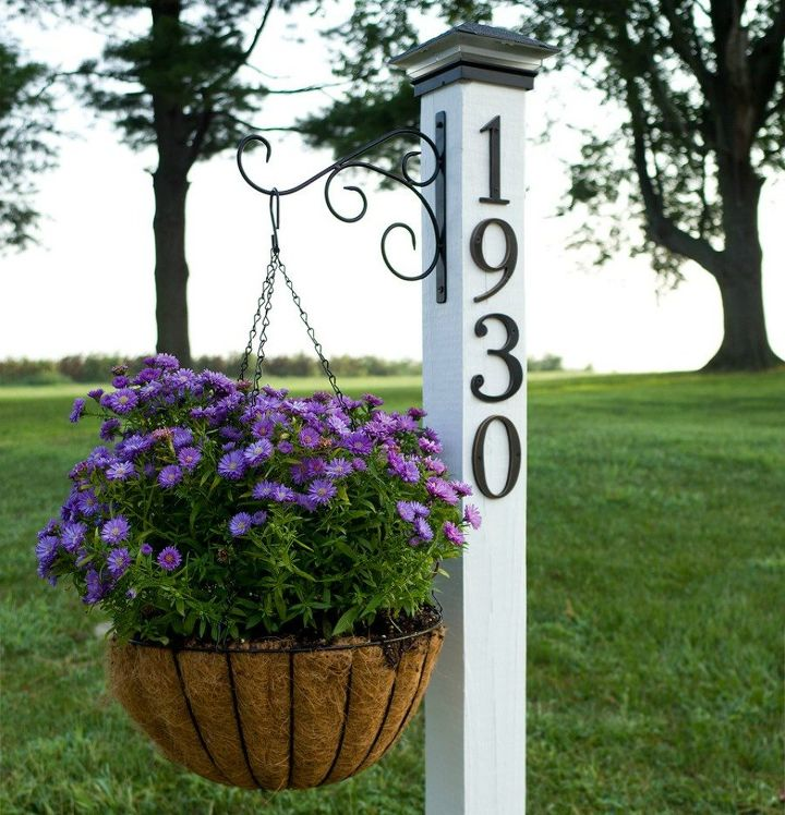 s 11 gorgeous address signs that ll make neighbors stop in admiration, crafts, curb appeal, outdoor living, Hang your house number on a planter post