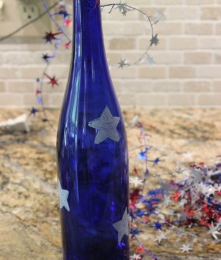 4th of july wine bottle centerpiece, crafts, patriotic decor ideas, repurposing upcycling, seasonal holiday decor