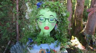 , Spray painted with a glow in the dark paint She now puts on a show in my garden