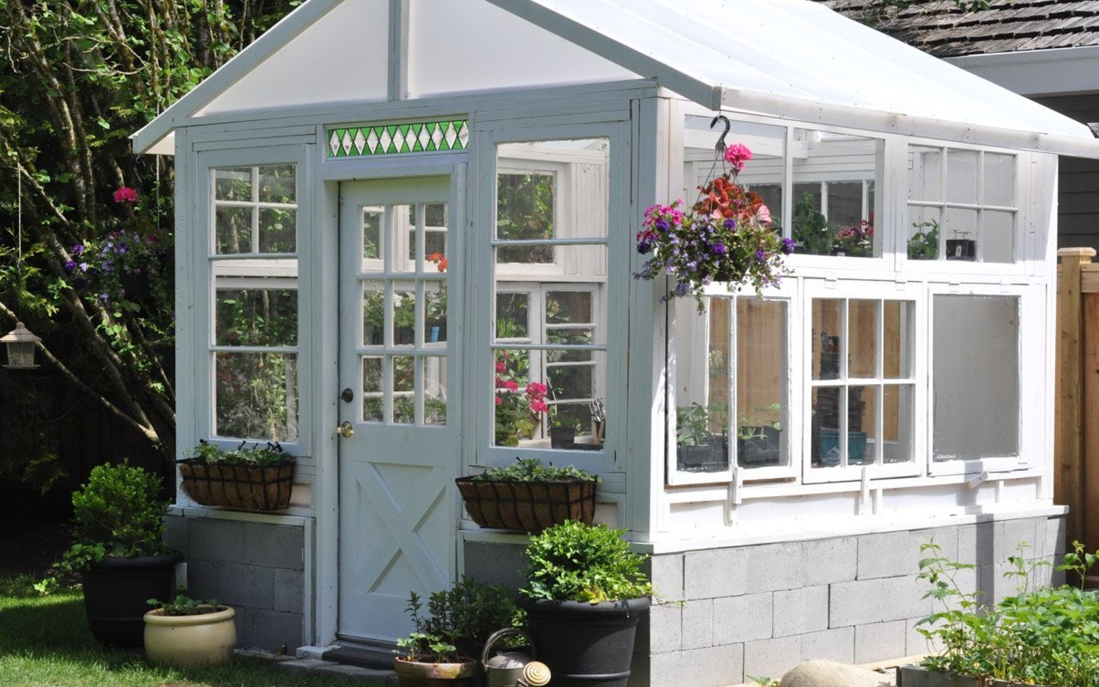 s wait they did what in their backyard , outdoor furniture, outdoor living, Build a greenhouse from vintage windows