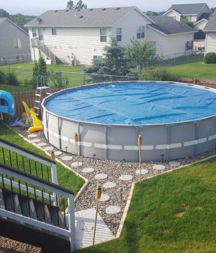 s wow 11 dreamy ideas for people who have backyard pools, outdoor living, pool designs, Add a river rock path around your pool