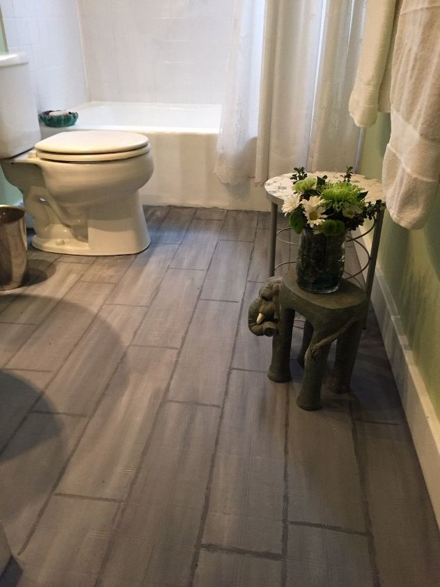 s here s how to totally transform your old floors on the cheap, flooring, how to, Paint a planked wood floor over ugly tile