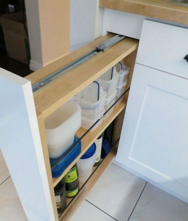 s 11 storage hacks that will instantly declutter your kitchen, kitchen design, organizing, storage ideas, Turn a filler panel into a pull out cabinet