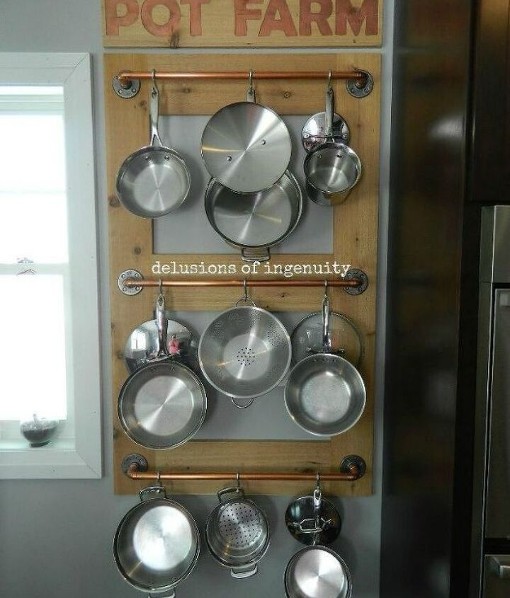 s 11 storage hacks that will instantly declutter your kitchen, kitchen design, organizing, storage ideas, Hang up your pots using crossbars and hooks