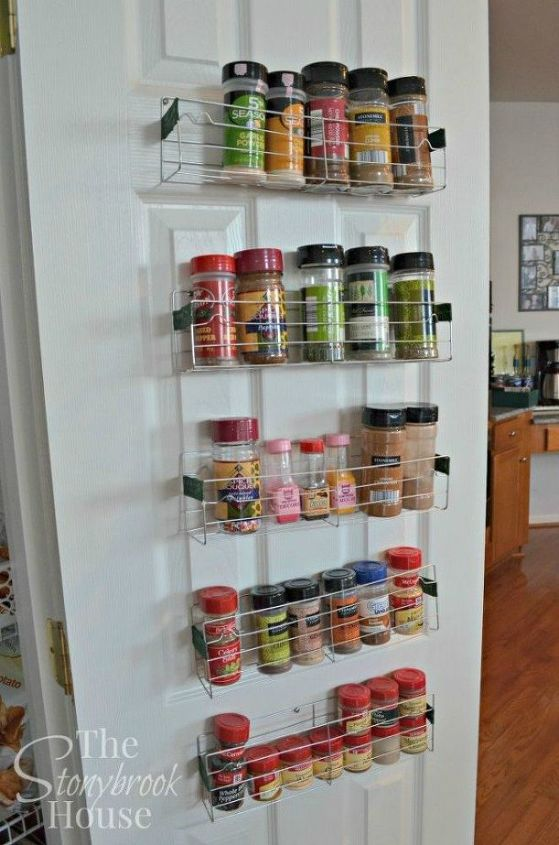 s 11 storage hacks that will instantly declutter your kitchen, kitchen design, organizing, storage ideas, Hang a spice rack on the door