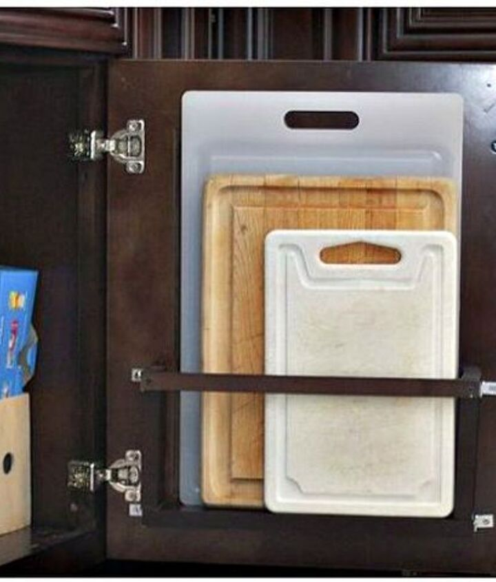 s 11 storage hacks that will instantly declutter your kitchen, kitchen design, organizing, storage ideas, Store cutting boards on your cabinet door
