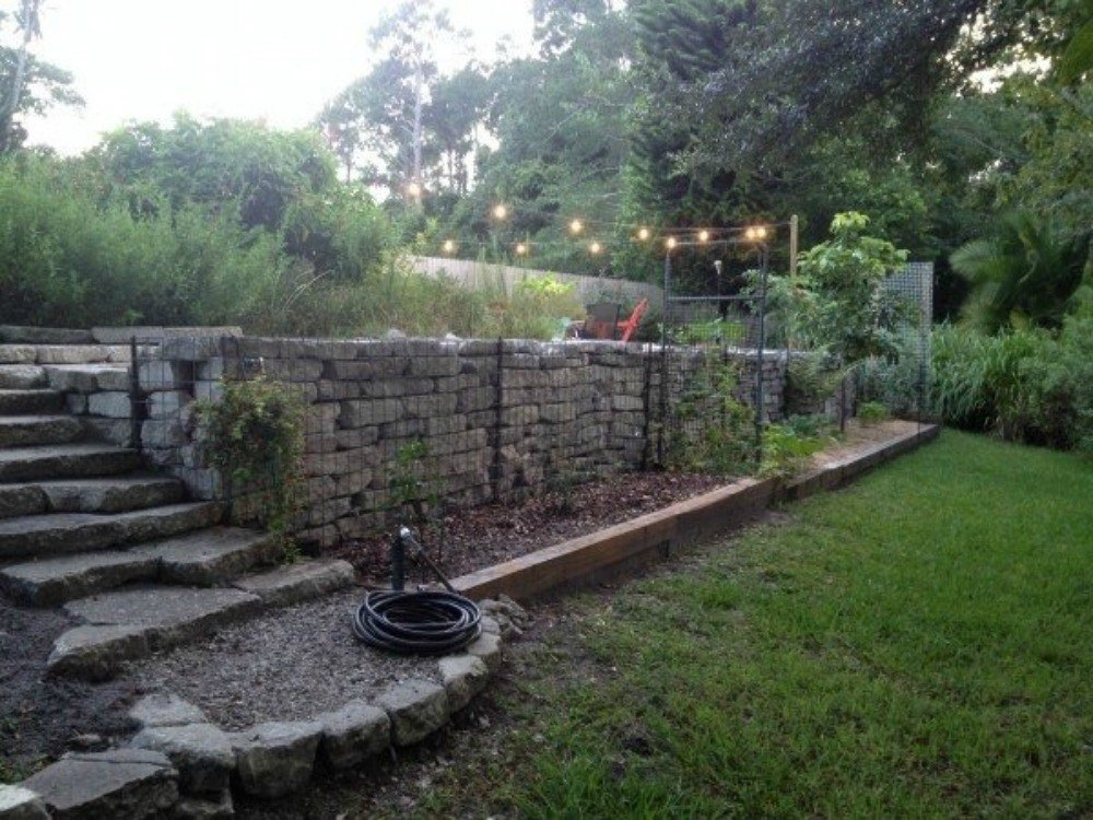 Here's What People Are Doing With Their Sloped Backyards ... on Retaining Wall Ideas For Sloped Backyard id=81306