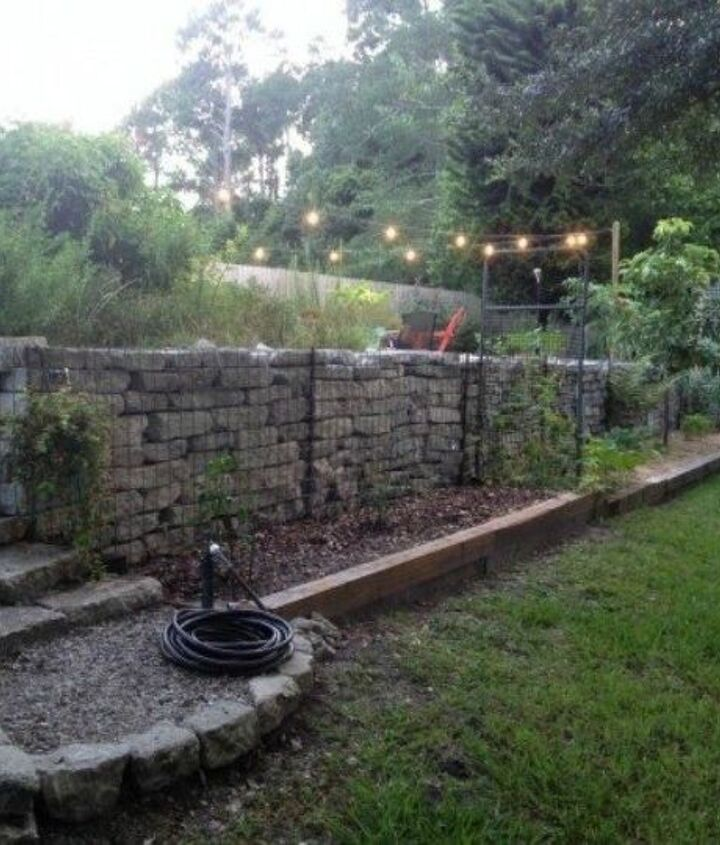 s here s what people are doing with their sloped backyards, gardening, landscape, Recycle material for Gabion Walls