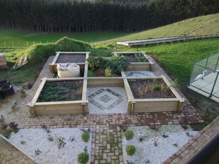 s here s what people are doing with their sloped backyards, gardening, landscape, Build raised garden beds