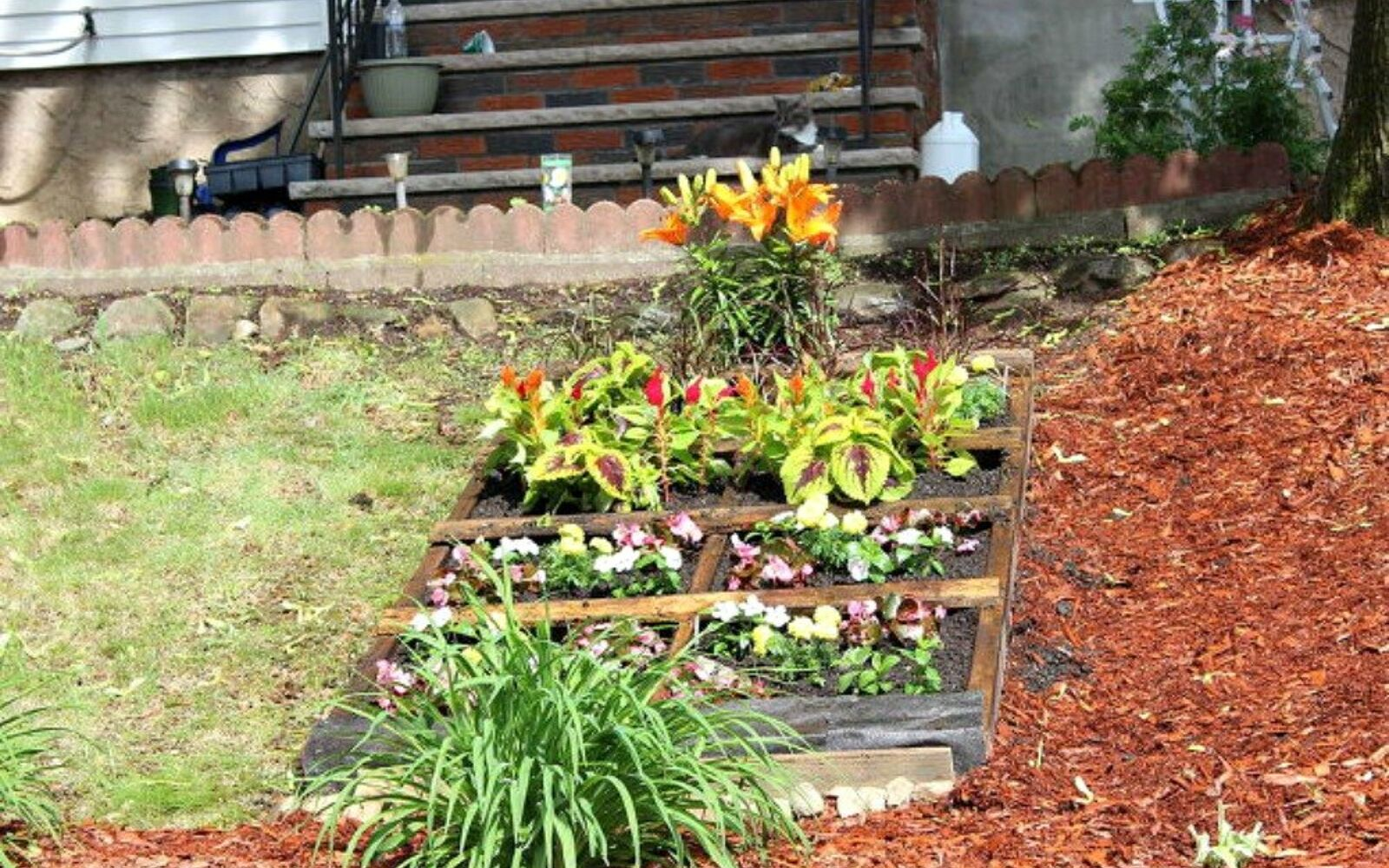 s here s what people are doing with their sloped backyards, gardening, landscape, Place a pallet garden