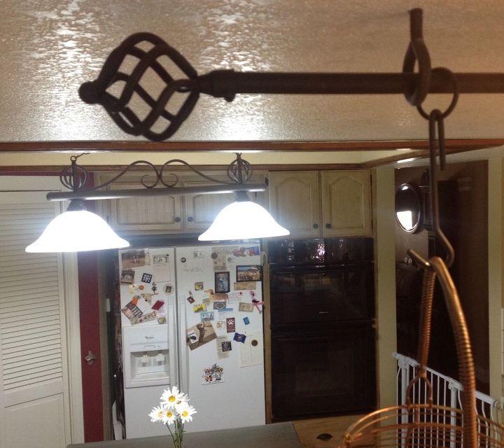 make a pot rack using a drapery rod , organizing, repurposing upcycling, storage ideas